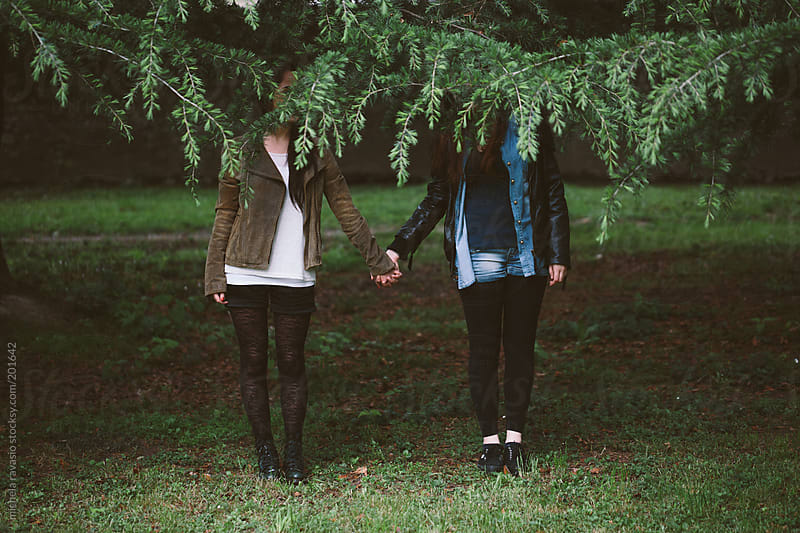 Two girls holding hands by michela ravasio for Stocksy United