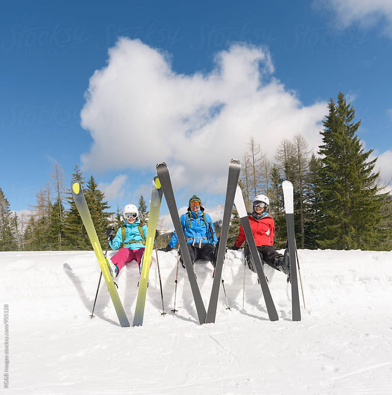 Friends on the ski slope taking a break by RG&B Images for Stocksy United