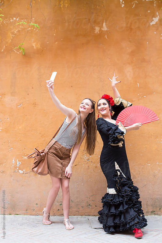 Tourist with Flamenco Dancer. Spain. by Hugh Sitton for Stocksy United