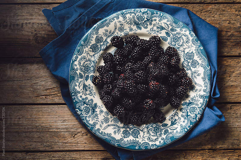 Ripe blackberries in plate  by Pixel Stories for Stocksy United