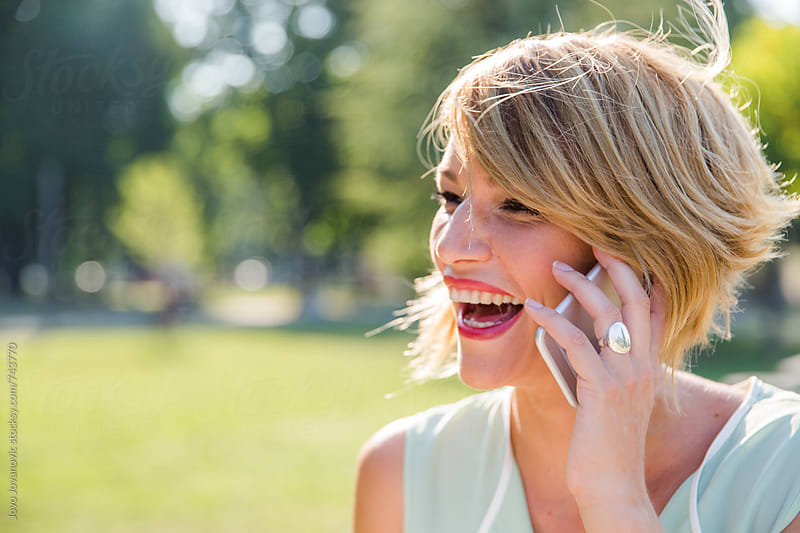 Beautiful woman talking on the phone by Jovo Jovanovic for Stocksy United