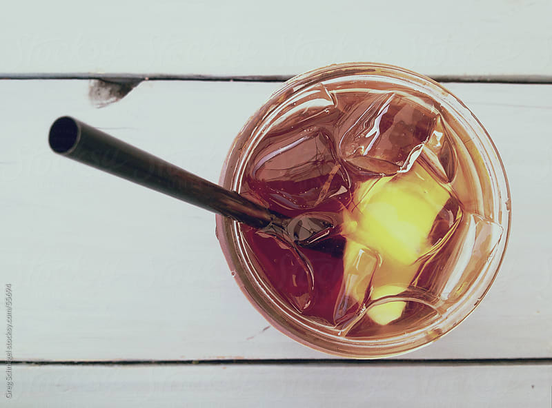 A glass of summertime iced tea by Greg Schmigel for Stocksy United