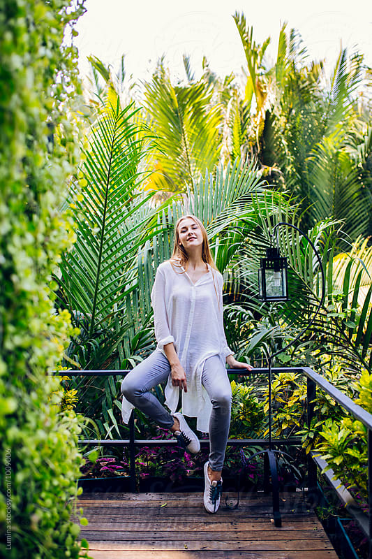 Woman Relexing in a Tropical Garden by Lumina for Stocksy United