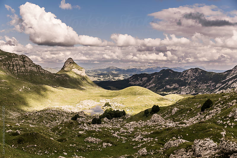 Beautiful green valley with mountains around, Durmitor Montenegro by Lior + Lone for Stocksy United