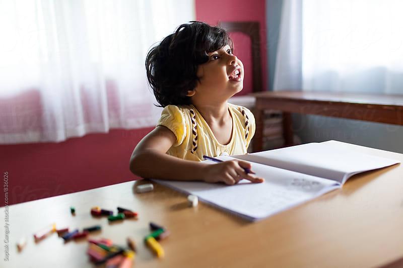 Little girl asking for help in her studies by Saptak Ganguly for Stocksy United