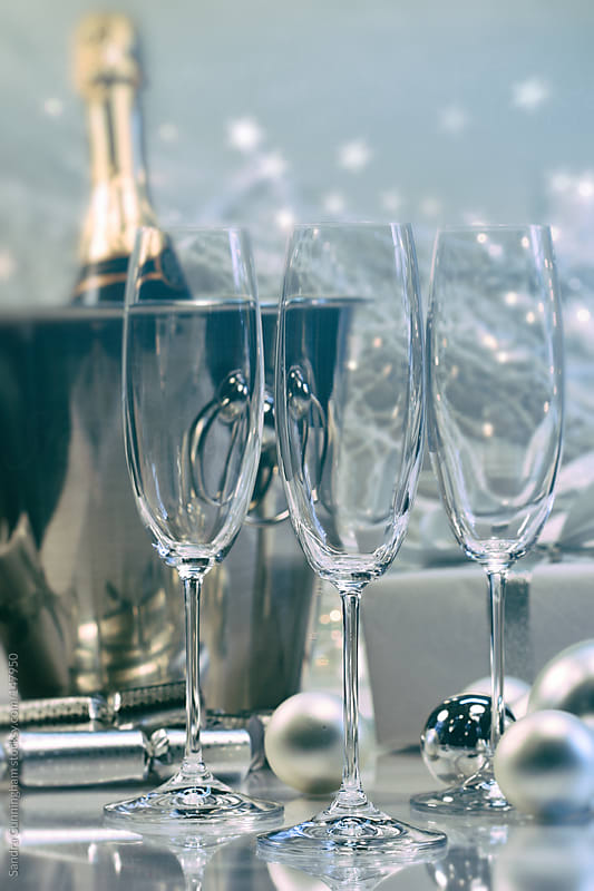 Empty flutted glasses with champagne in ice bucket by Sandra Cunningham for Stocksy United