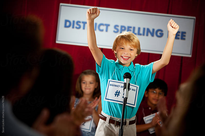 Spelling: Boy Spells Word Correctly and Cheers by Sean Locke for Stocksy United