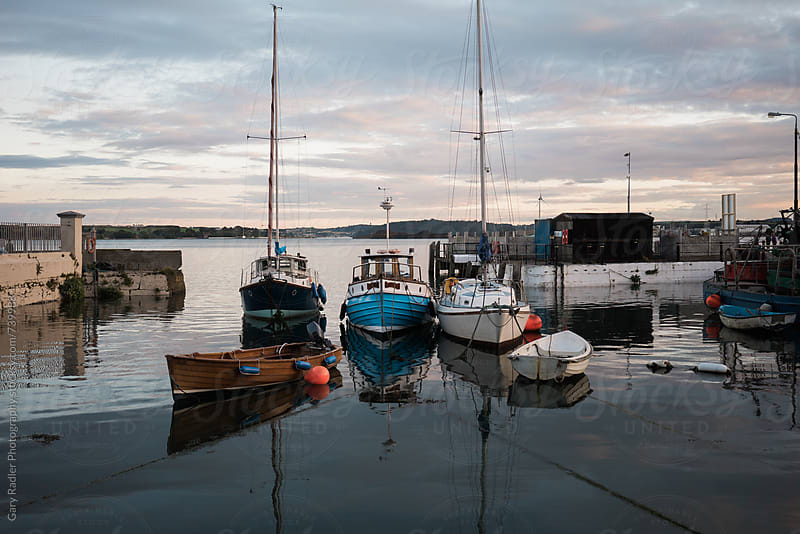 Boats moored in Cobh, Ireland by Gary Radler Photography for Stocksy United