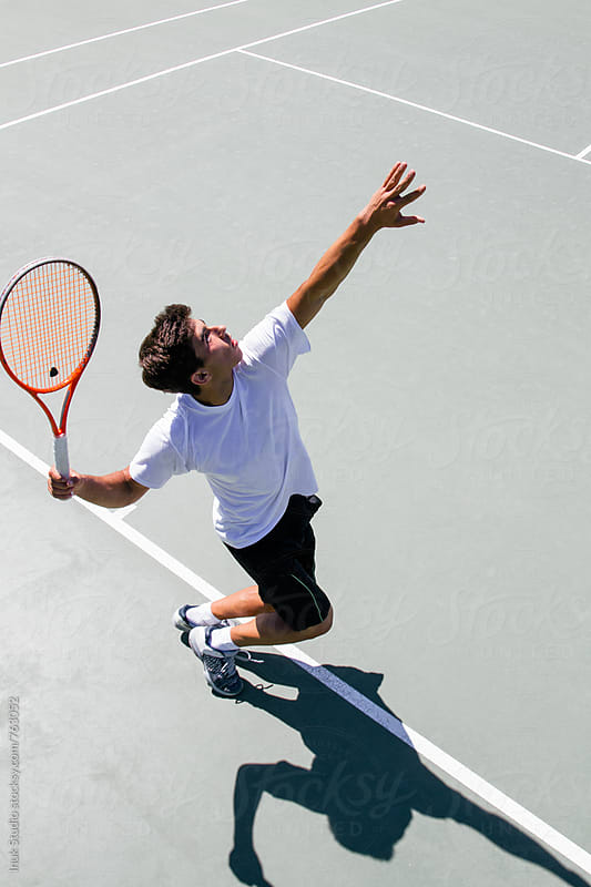 Tennis player serving in a tennis court seen from above by Inuk Studio for Stocksy United