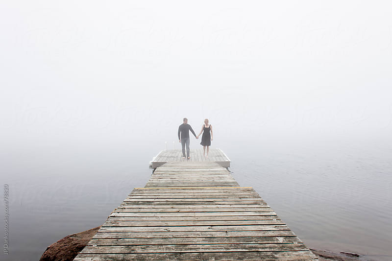 Man and Woman On Dock In Misty Morning by JP Danko for Stocksy United