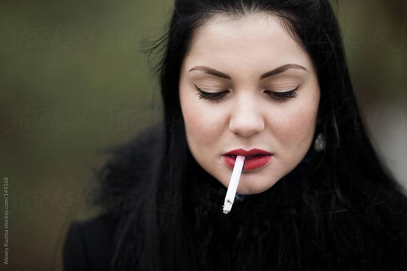 she is smoking by Alexey Kuzma for Stocksy United