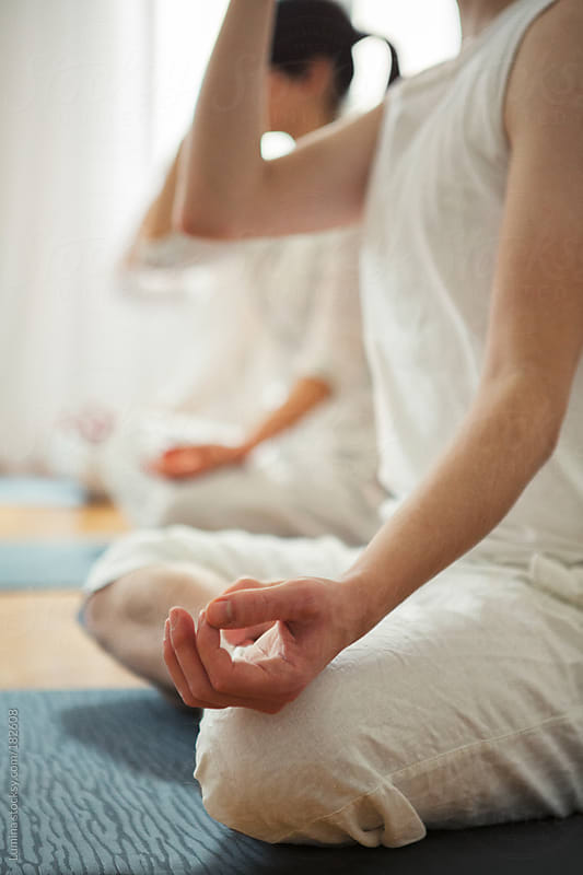 Group Meditation in a Yoga Class by Lumina for Stocksy United