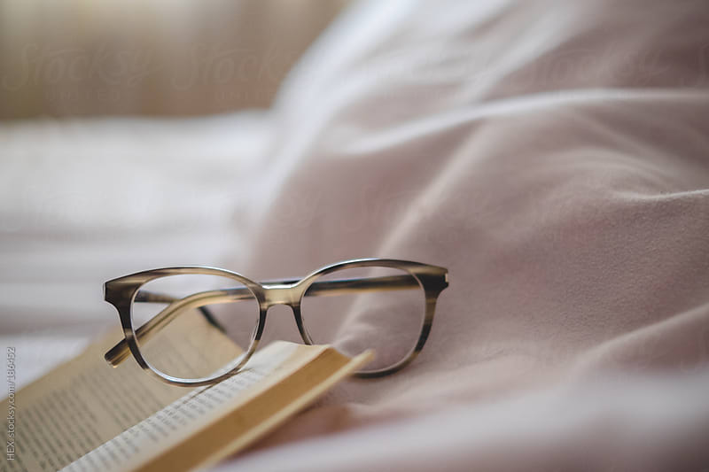 Book and Glasses on Bed  by HEX. for Stocksy United