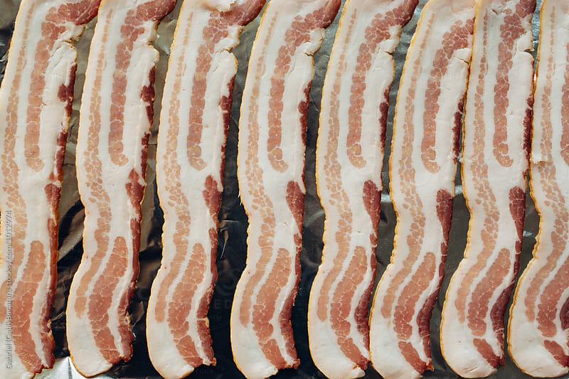 Raw bacon from overhead by Gabriel (Gabi) Bucataru for Stocksy United