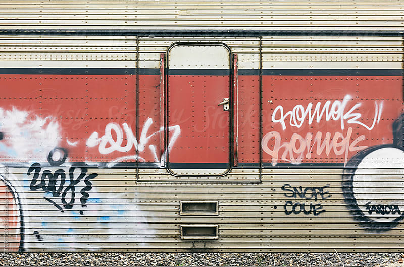 Closed Door of an Abandoned Train with Graffities by Victor Torres for Stocksy United