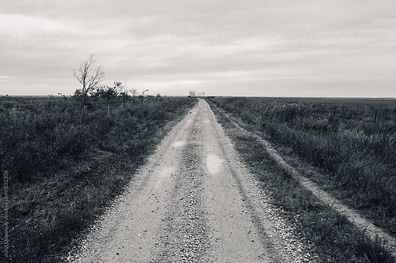 An old gravel road by John Dunaway for Stocksy United