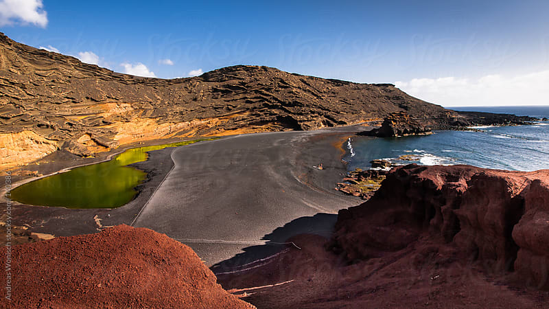 Green Lagoon on Volcanic Beach in Lanzarote by Andreas Wonisch for Stocksy United