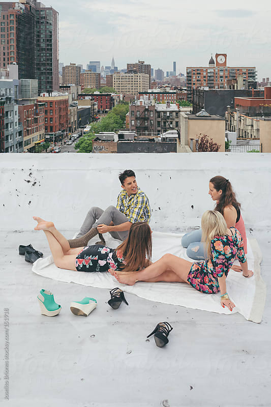 Friends Hanging Out on a New York Rooftop by Joselito Briones for Stocksy United