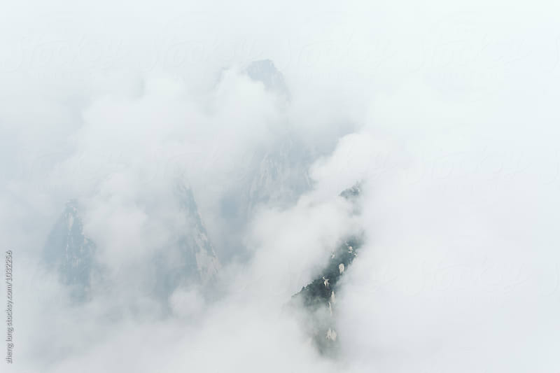 Huashan Mountain  hiding in the cloud by zheng long for Stocksy United
