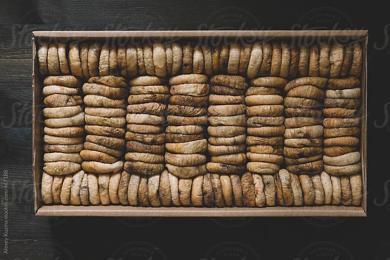 box with dried figs by Alexey Kuzma for Stocksy United