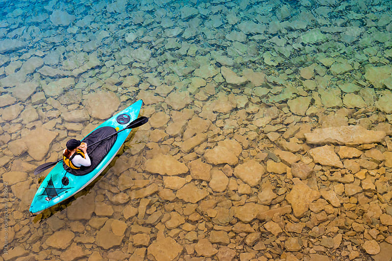 Woman Enjoying Morninig Coffee While Sea Kayak Paddling on Clear Freshwater Lake at Summer Cottage by JP Danko for Stocksy United