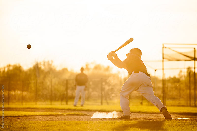 baseball at sunset by Paul Schlemmer for Stocksy United