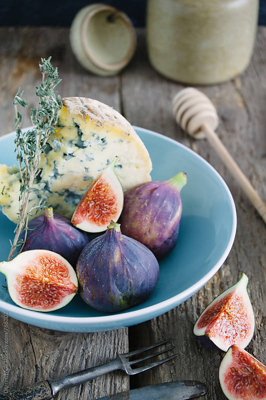 Blue cheese and figs in a bowl on a table. by Darren Muir for Stocksy United