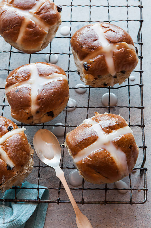 Hot buns drizzled with sweet icing by Nadine Greeff for Stocksy United