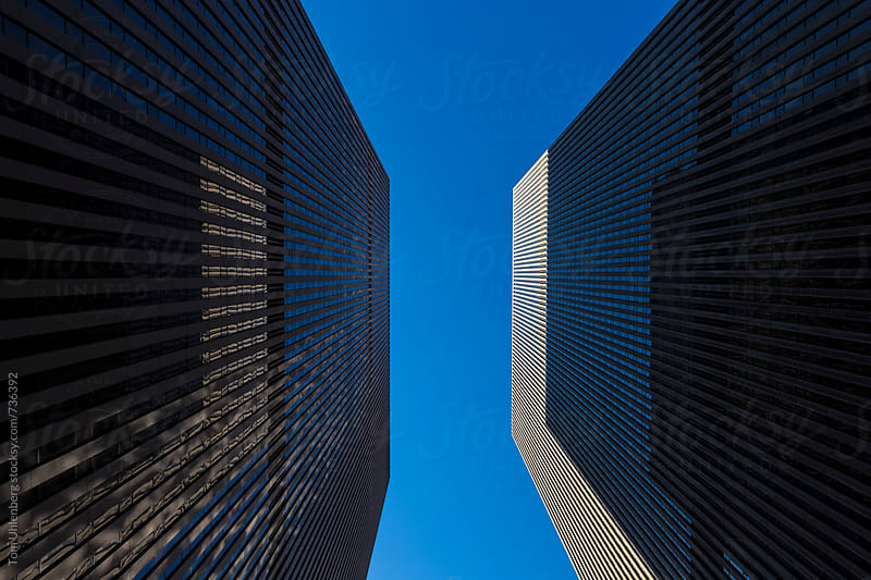 Upward Perspective of Two Skyscrapers in New York by Tom Uhlenberg for Stocksy United
