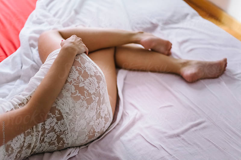 Woman sleeping on the bed by GIC for Stocksy United