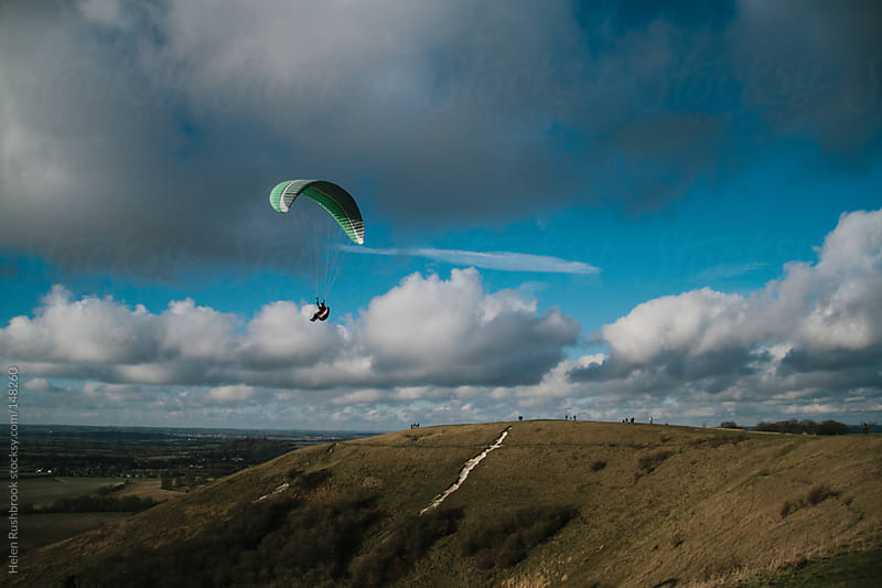 A paraglider by Helen Rushbrook for Stocksy United