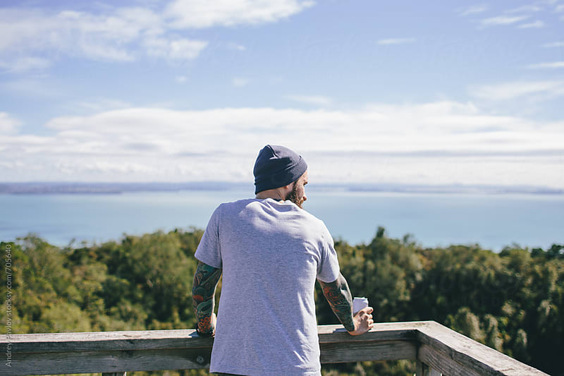 Hipster man on a view point from behind by Andrey Pavlov for Stocksy United