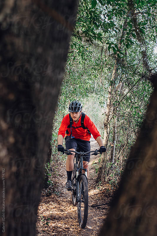Male mountain bike rider on a forest trail by Gabriel (Gabi) Bucataru for Stocksy United