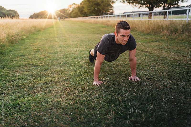 Athlete trains outdoors by HEX . for Stocksy United