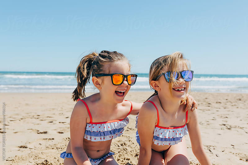 Little Sisters Having Fun at the Beach