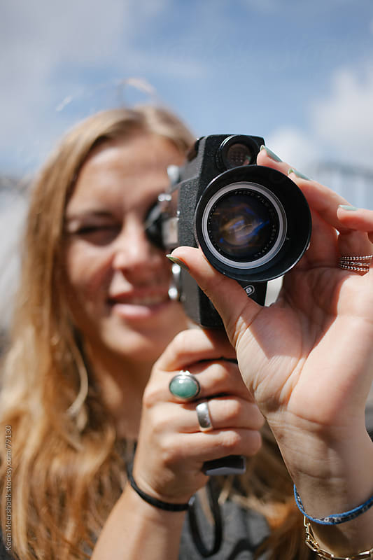 Young woman filming with an old camera. by Koen Meershoek for Stocksy United