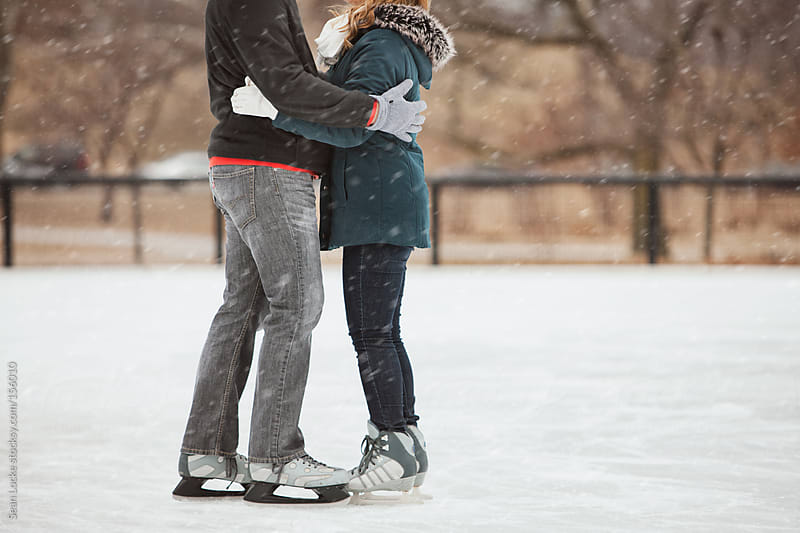 Skating: Anonymous Couple Hugging On Skating Date by Sean Locke for Stocksy United