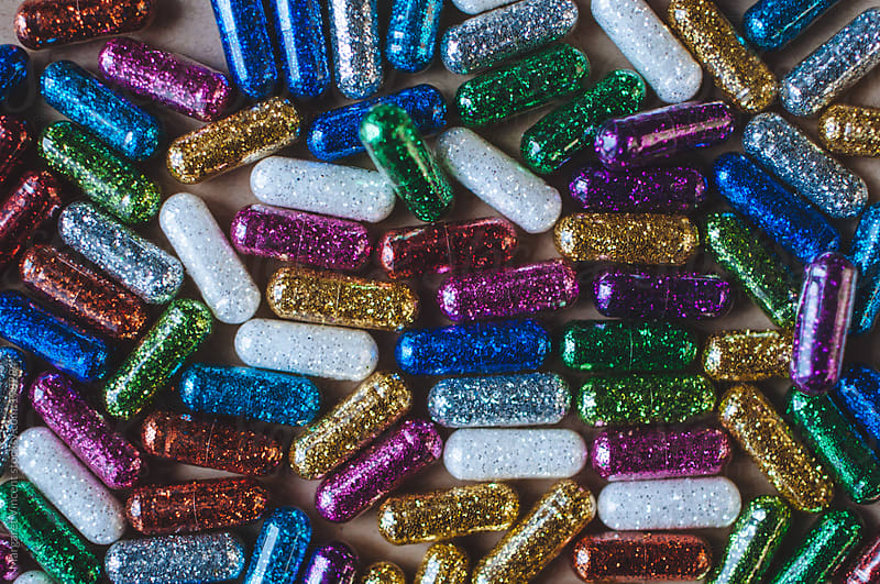 multicolored glitter pills by Margaret Vincent for Stocksy United