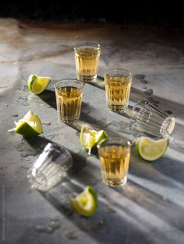 Tequila Shots with Limes by Jeff Wasserman for Stocksy United