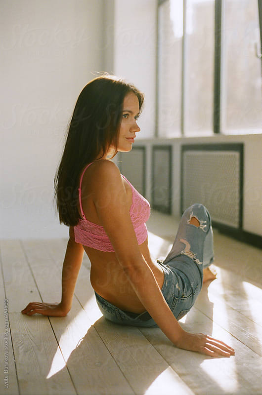 Woman sitting on floor in studio by Lyuba Burakova for Stocksy United