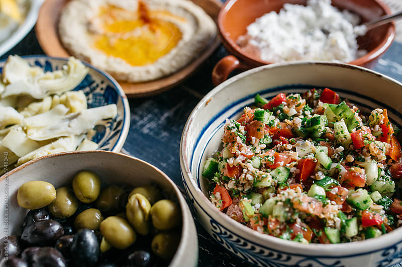 Tabouleh, olives, hummus and artichokes by Gabriel (Gabi) Bucataru for Stocksy United