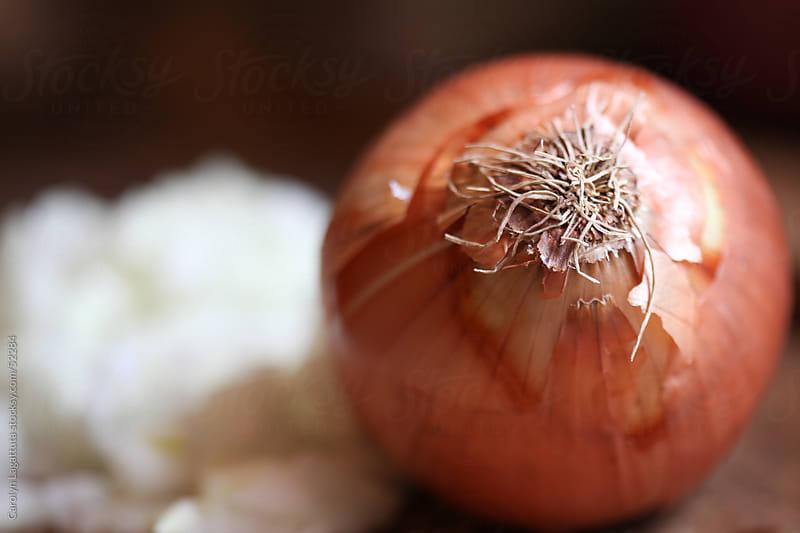 Beautiful  golden onion on a cutting board. by Carolyn Lagattuta for Stocksy United