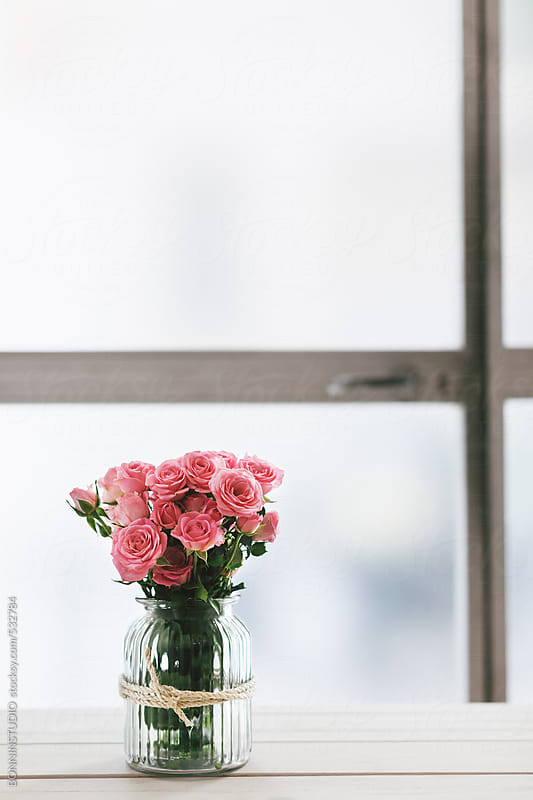 Bouquet of a pink roses on a white table.  by BONNINSTUDIO for Stocksy United