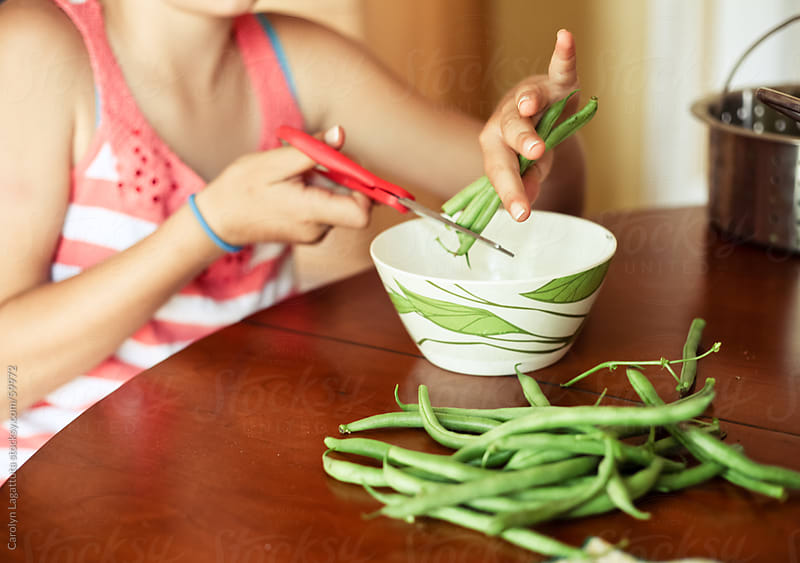 Cutting green beans by Carolyn Lagattuta for Stocksy United