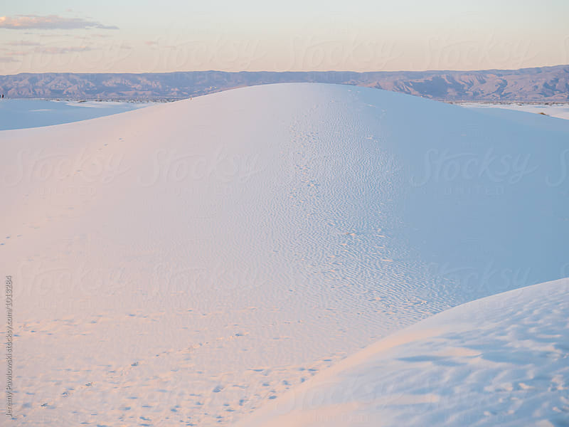Sunshine on white sand dunes in New Mexico by Jeremy Pawlowski for Stocksy United