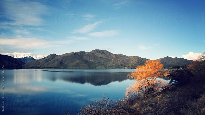 Mountains reflected in lake by Kaat Zoetekouw for Stocksy United