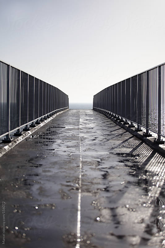 Bridge leading to sea by Marcel for Stocksy United