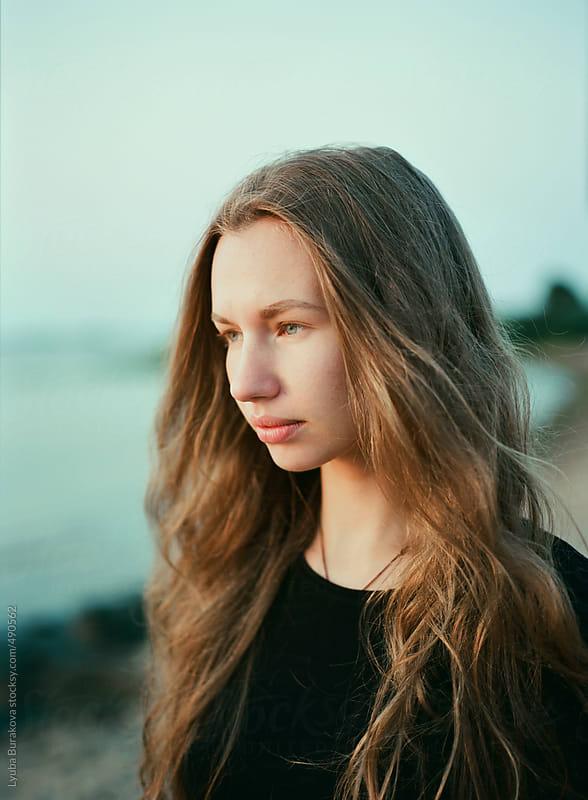 Portrait of the beautiful woman looking at the sunset by Lyuba Burakova for Stocksy United