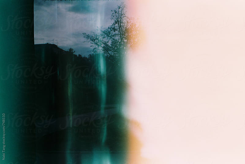 Light leak photo of random location shot by old film camera. by Nabi Tang for Stocksy United