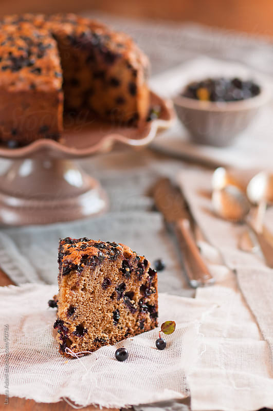 a slice of blueberries wholemaeal cake  by Laura Adani for Stocksy United